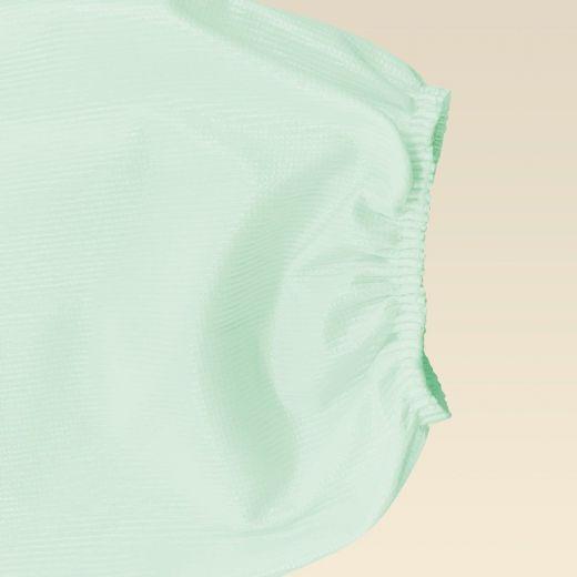 Bata impermeable lavable y reutilizable verde claro detalle puño